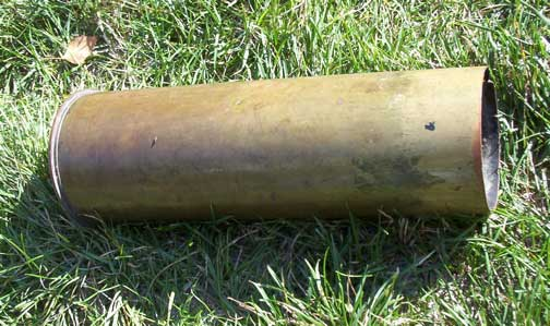 [a copper WWII tank shell casing]