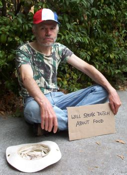 [Me as a beggar holding a sign 'Will Speak Dutch about Food']