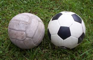 [a brown and a dotted soccer ball]