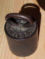 [an old kilogram weight]