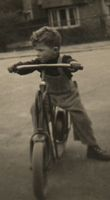[Then: me as a child on a scooter]