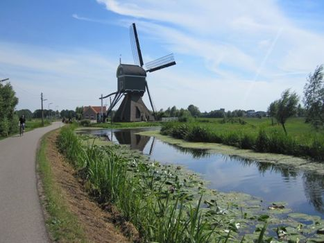 [windmill, canal, bike path]