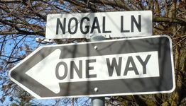 ['Nogal Lane' street sign]