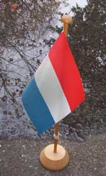 [The Flag of The Netherlands, at the edge of water]